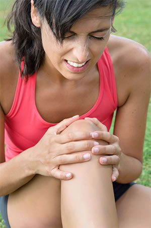 Lady In Need Of Arthritis Chiropractic Care For Her Knee