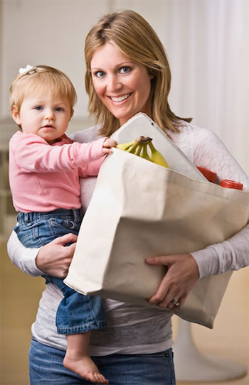 Mother Carrying Baby And Groceries After Sports Chiropratic Care Treatments