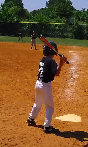 Boy Playing Baseball As A Result Of Children Chiropractic Care