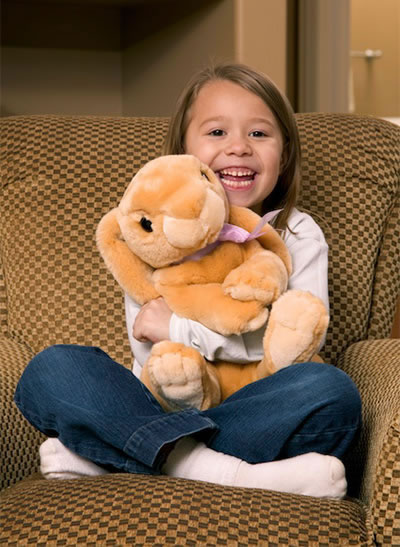 Girl Hugging Her Stuffed Rabbit After Her Ear Infections Chiropractic Treatment
