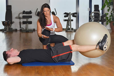Man Exercising With Weight Loss Chiropractic Treatments