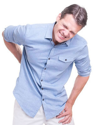 Man Hunched Over In Pain Lacking Chiropractic Care For Herniated Disc