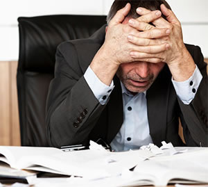 Man In Need Of Stress Chiropractic Care