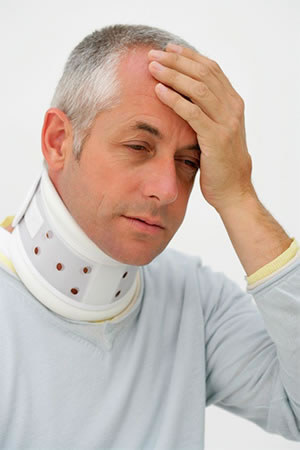 Man with neck brace and headache