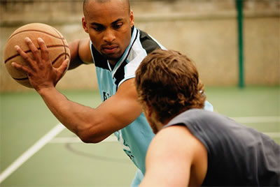 2 Men Playing Basketball With After Receiving Sports Chiropractic Care