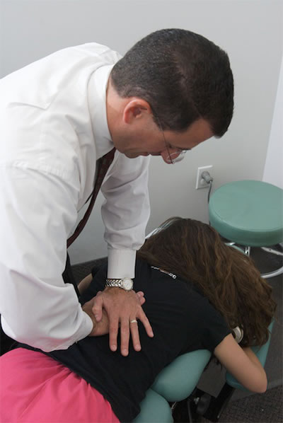 Dr. Lombardozzi Adjusting A Patient Who Chose A Chiropractor vs Orthopedist