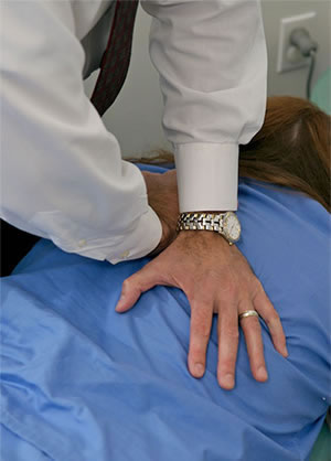 Dr Lombardozzi Adjusting Patient With Chiropractic Care