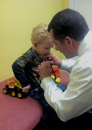 Dr Lombardozzi Providing Children Chiropractic Care