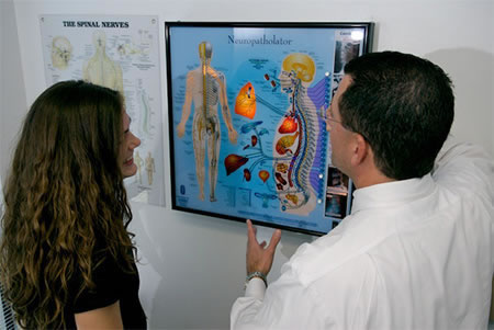 Dr Lombardozzi Explaining Neuropatholater Patient In Chiropractic Care