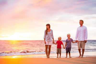 Family Walking on Beach after Chiropractic Treatments in Virginia Beach